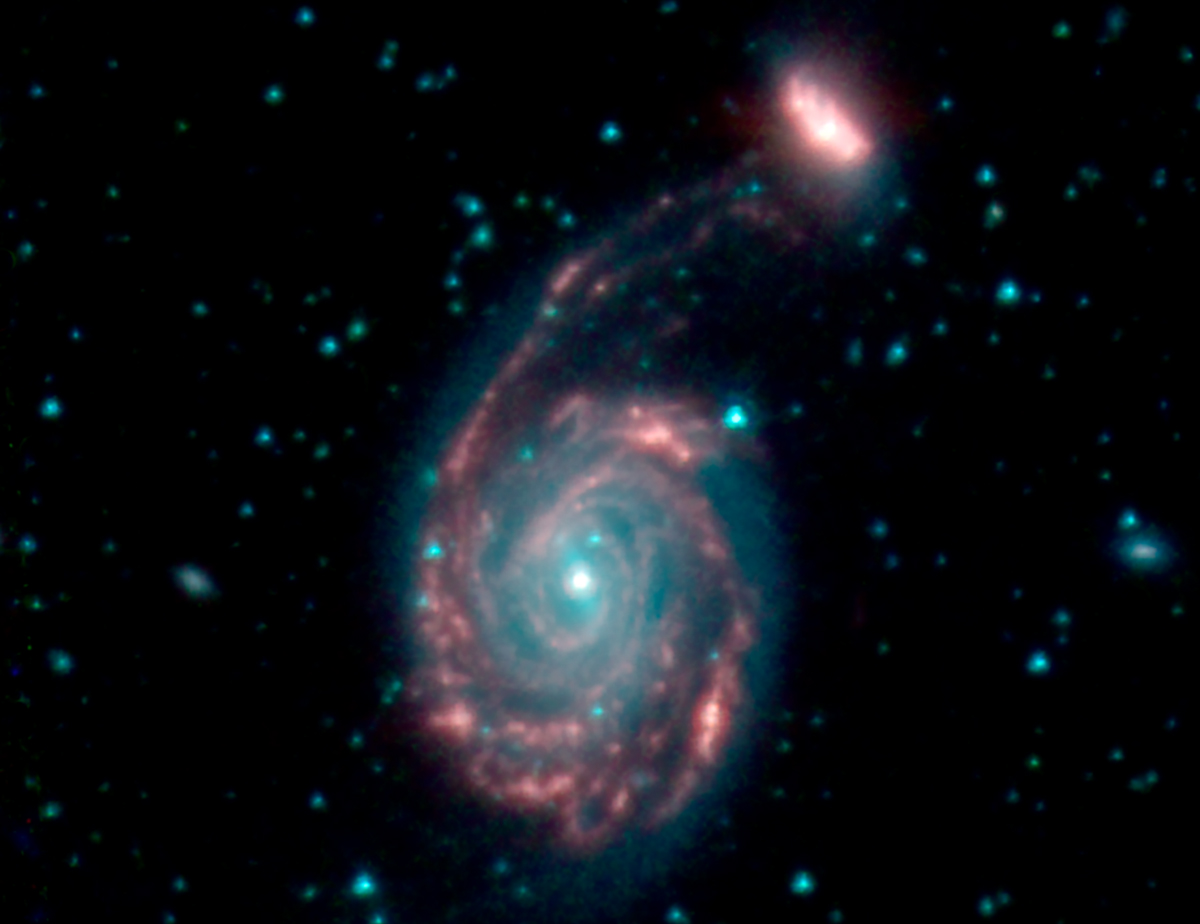 Spitzer space telescope images merging, swirling galaxies.