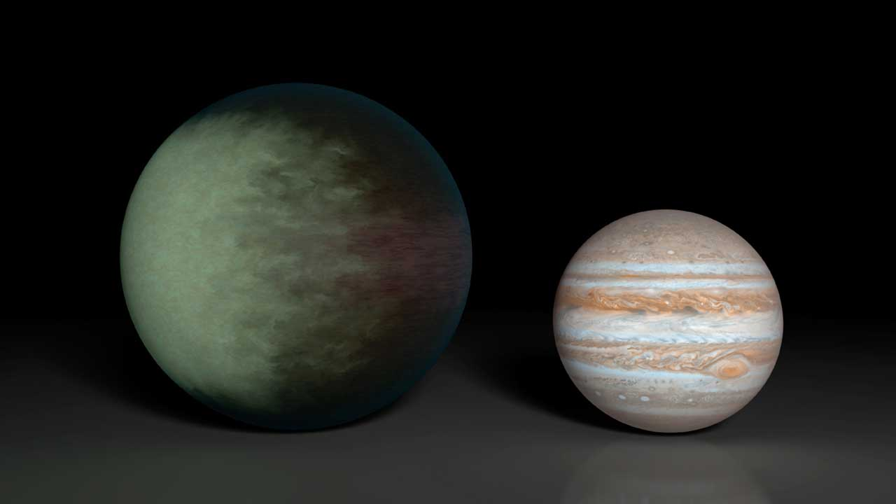 Greenish blue clouds are see on an exoplanet compared with Jupiter in this artist's illustration