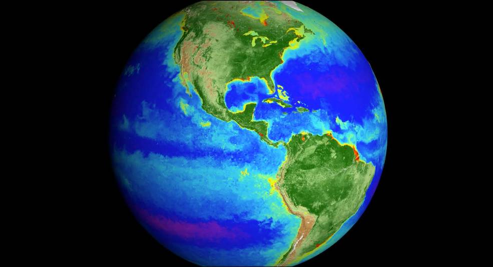 Earth is seen with life indicated in bright colors in the ocean and on land.