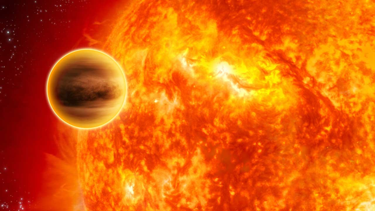 A large planet is seen close to a fiery star like our sun.