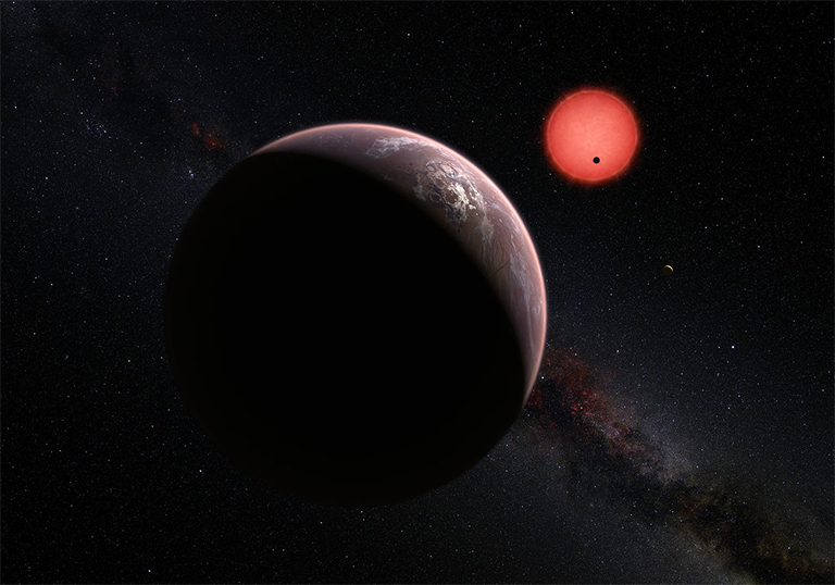 Artist's impression of the ultracool dwarf star TRAPPIST-1 and its three planets. In this view one of the inner planets is seen in transit across the disc of its tiny and dim parent star. Credit: ESO/M. Kornmesser/N. Risinger