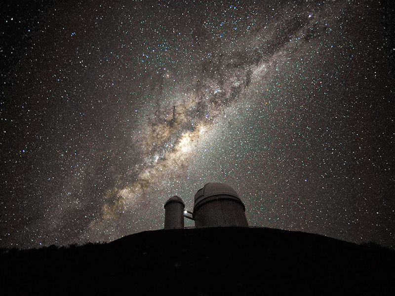 Milky Way Galaxy above telescope.
