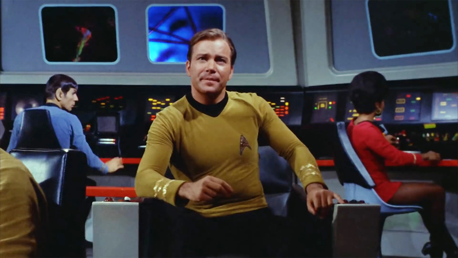 slide 3 - Captain Kirk sits in his chair on the bridge of the U.S.S. Enterprise.