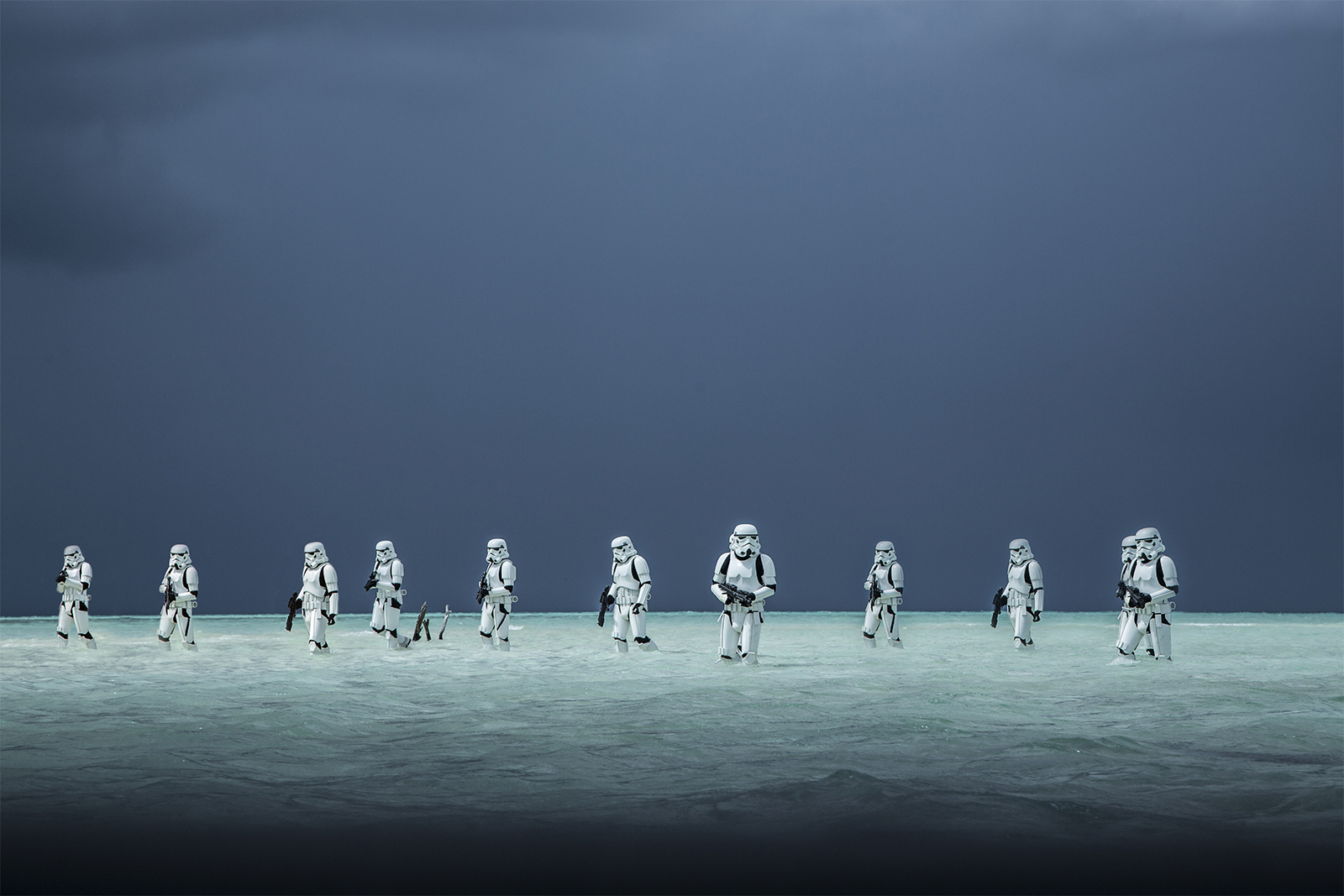 "slide 5 - Stormtroopers in the new Star Wars film ""Rogue One"" wade through the water of an alien ocean world."