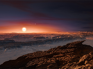 This artist's impression shows a view of the surface of the planet Proxima b orbiting the red dwarf star Proxima Centauri, the closest star to the solar system. The double star Alpha Centauri AB also appears in the image. Proxima b is a little more massive than the Earth and orbits in the habitable zone around Proxima Centauri, where the temperature is suitable for liquid water to exist on its surface. Credit: ESO/M. Kornmesser