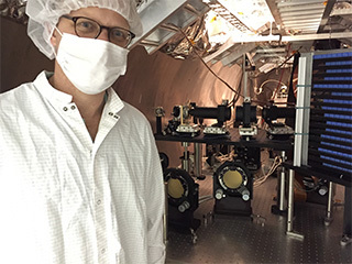 Photo of scientist with instrument