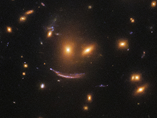 Hubble Finds Smiling Face in a Hunt for Newborn Stars
