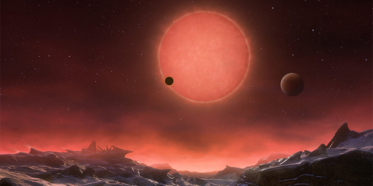 This artist's impression shows an imagined view from the surface one of the three planets orbiting an ultracool dwarf star just 40 light-years from Earth that were discovered using the TRAPPIST telescope at ESO's La Silla Observatory. These worlds have sizes and temperatures similar to those of Venus and Earth and are the best targets found so far for the search for life outside the Solar System. They are the first planets ever discovered around such a tiny and dim star. Credit: ESO/M. Kornmesser