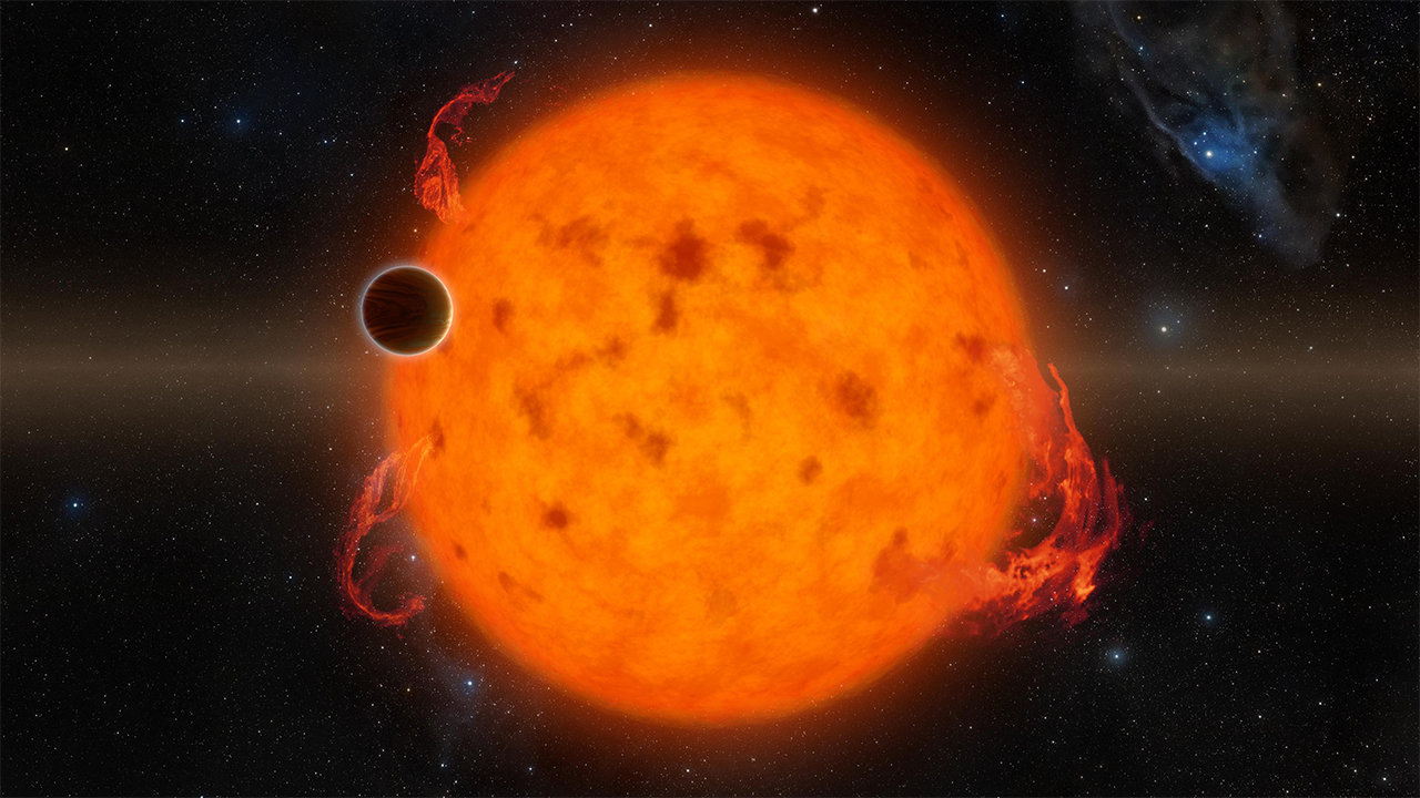 A small, dark planet transits in front of its fiery star.