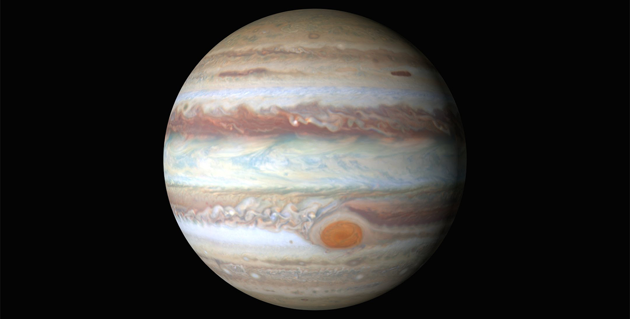 A photo of Jupiter from the Hubble Space Telescope. The map shows Jupiter's Great Red Spot and its striking striated bands of color.