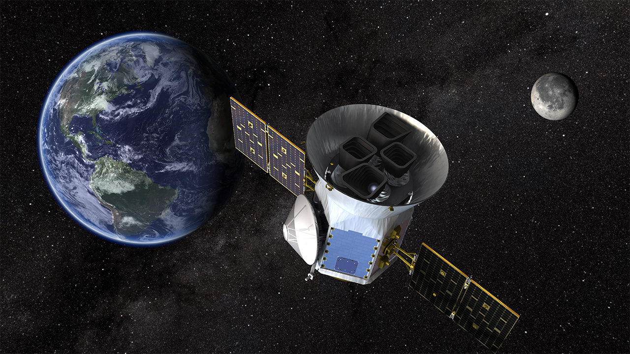An artist's concept of TESS, with Earth in the background.