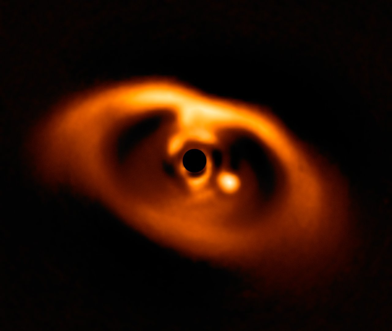 Image of a newborn planet forming around its star.