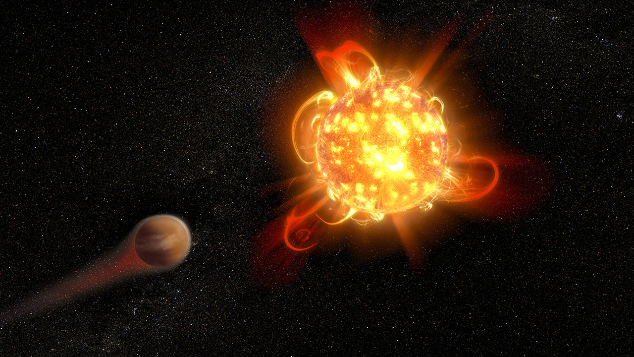A red dwarf star is shown with flares protruding from the surface and a smaller planet in the foreground.