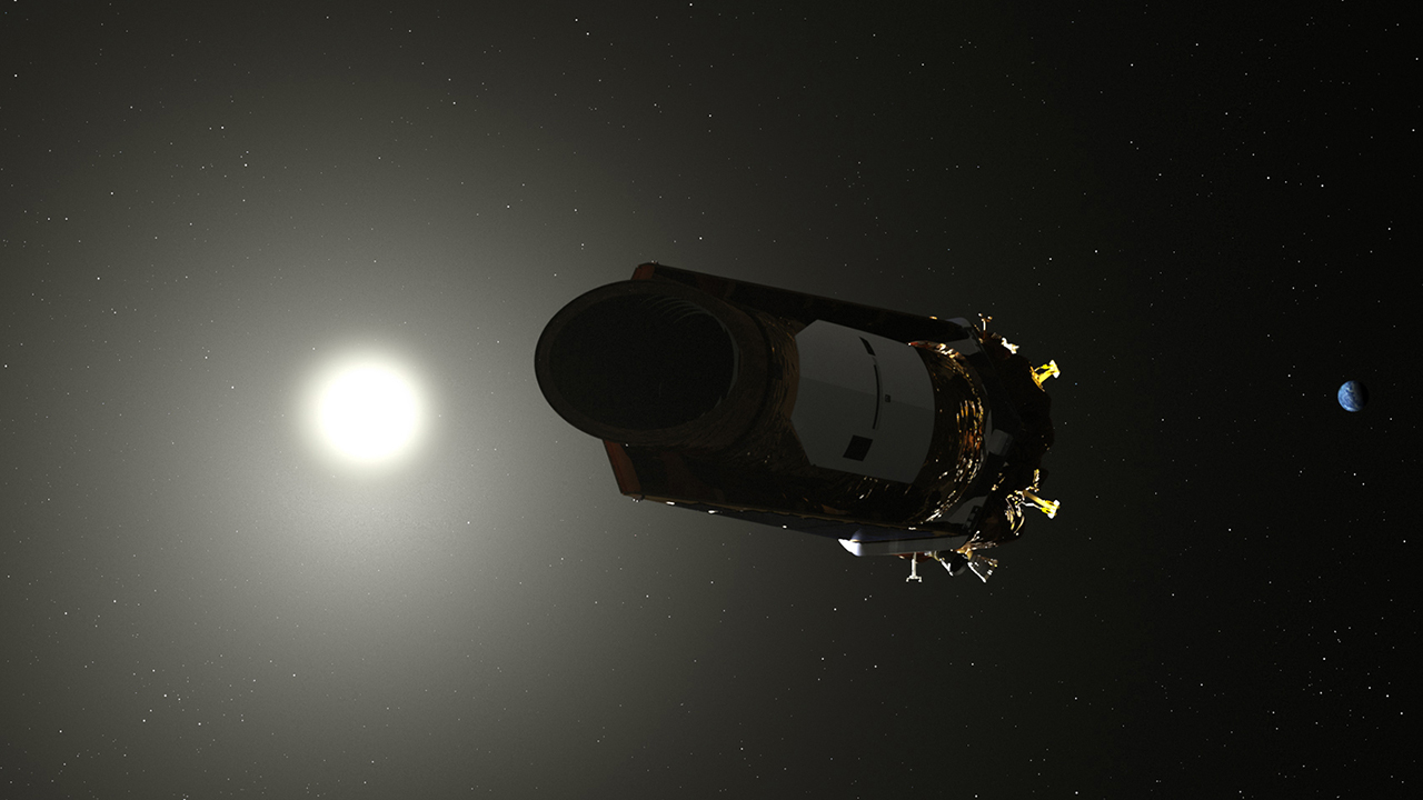 An image of the Kepler space telescope in orbit.
