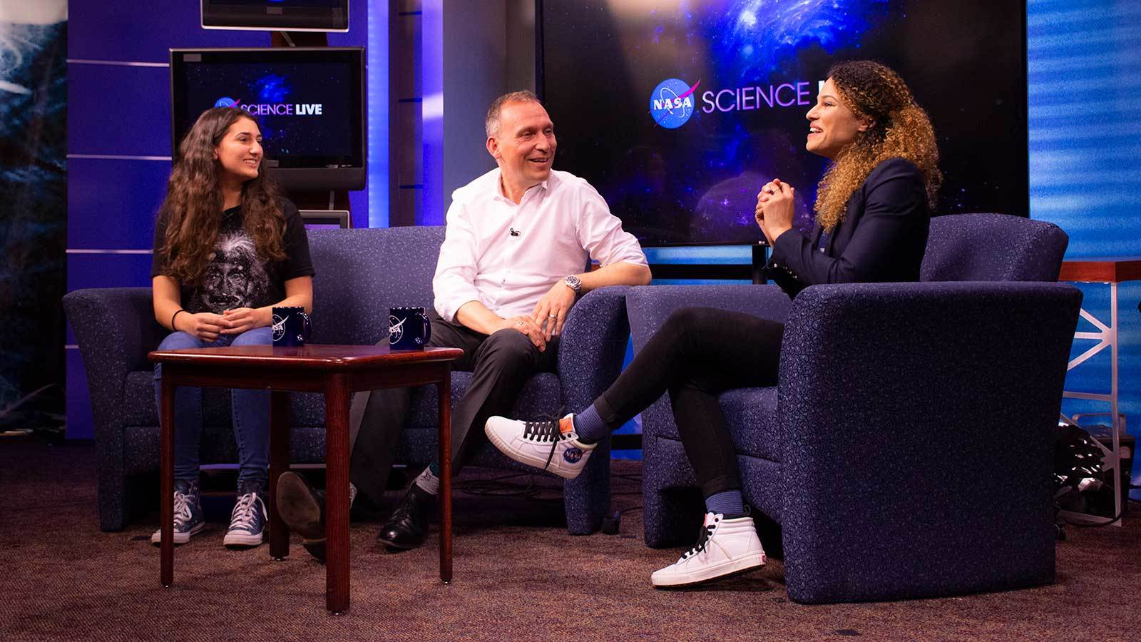Ana Humphrey, a high school student, appears with Dr. Thomas Zurbuchen  and Sophia Roberts on the NASA Science Live talkshow run out of Goddard Space Flight Center.