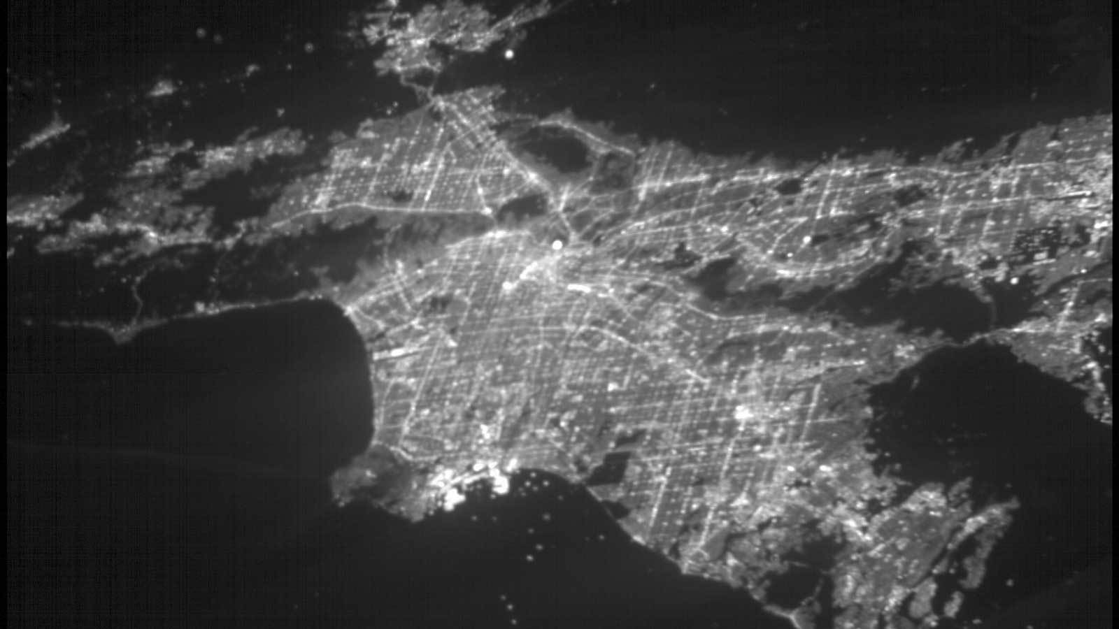 A black and white image of the lights of Los Angeles from space via the small satellite ASTERIA