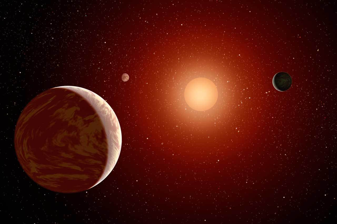 An M dwarf star is seen with three exoplanets.