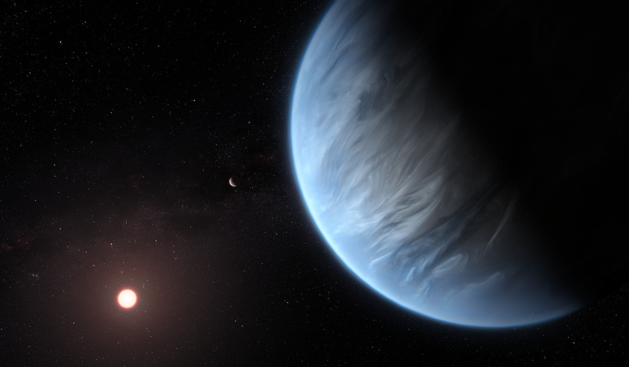 Artist's image of planet K2-18b with a companion planet and host star.