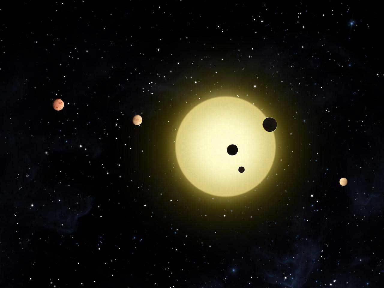 "Artist's rendering of six planets orbiting a Sun-like star, Kepler-11. A newly discovered system, also likely with six planets, includes a ""super-Earth"" and four ""mini-Neptunes."" Image credit: NASA/Tim Pyle."
