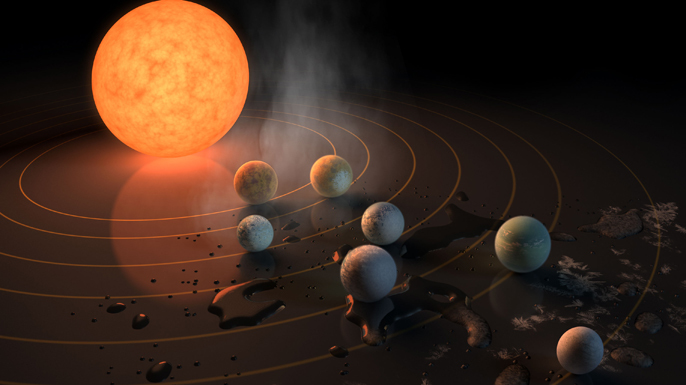 This illustration shows the seven Earth-size planets of TRAPPIST-1, an exoplanet system orbiting a red dwarf star about 40 light-years away.