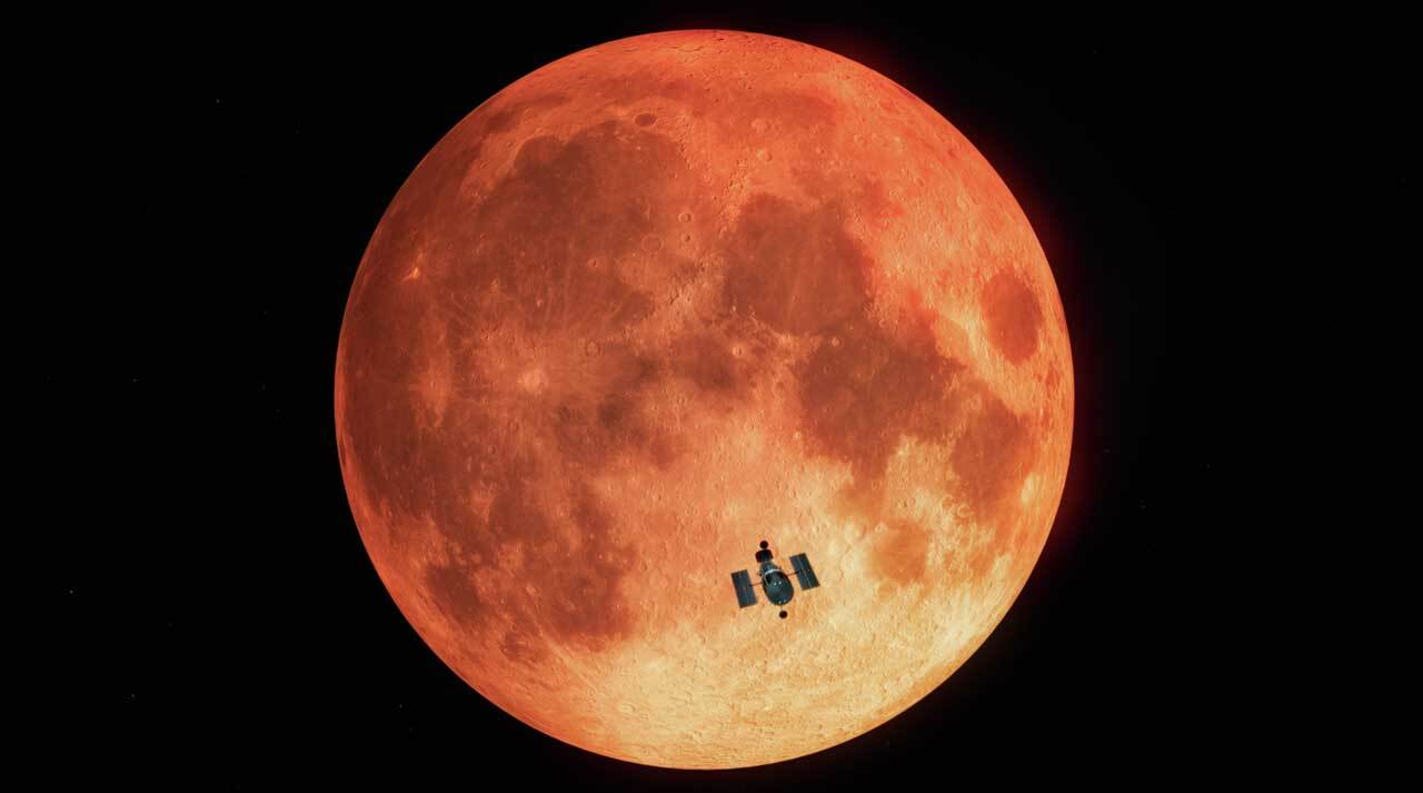 An image of the Hubble Space Telescope is superimposed on an image of a full reddish moon,
