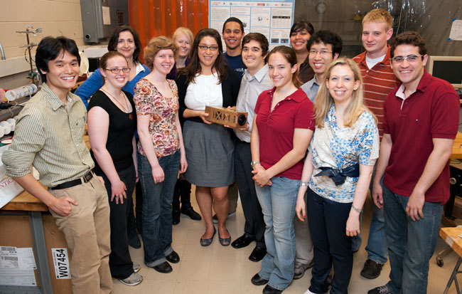 MIT Students pose with their exoplanet-finding CubeSat, scheduled to hitch a ride into space in 2012.