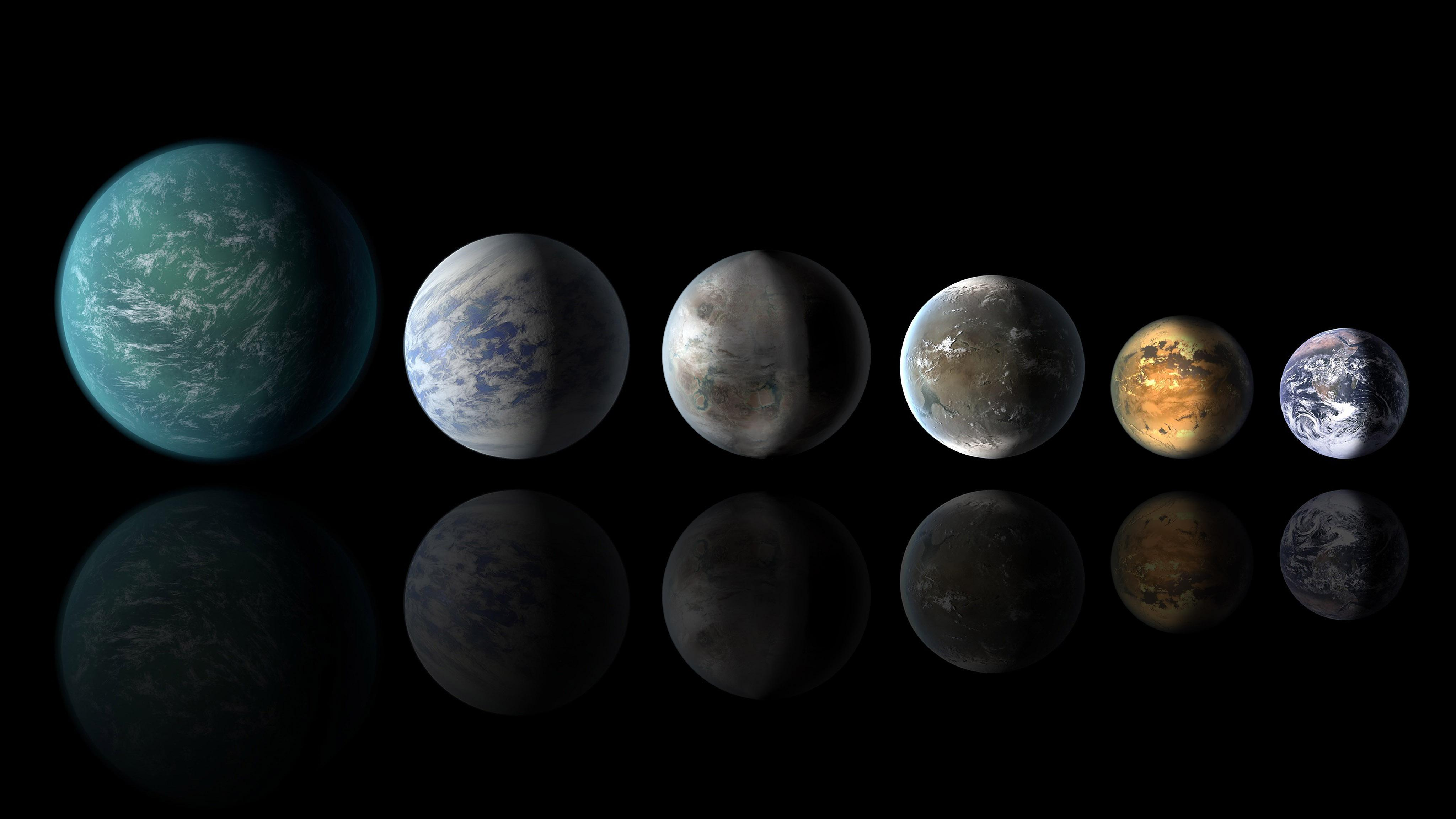 This year's search for another Earth brought discoveries from the far-flung corners of the galaxy. This image shows the relative sizes of all of the habitable-zone planets discovered to date alongside Earth. Left to right: Kepler-22b, Kepler-69c, Kepler-62e, Kepler-62f and Earth (except for Earth, these are artists' concepts). Image credit: NASA Ames/JPL-Caltech